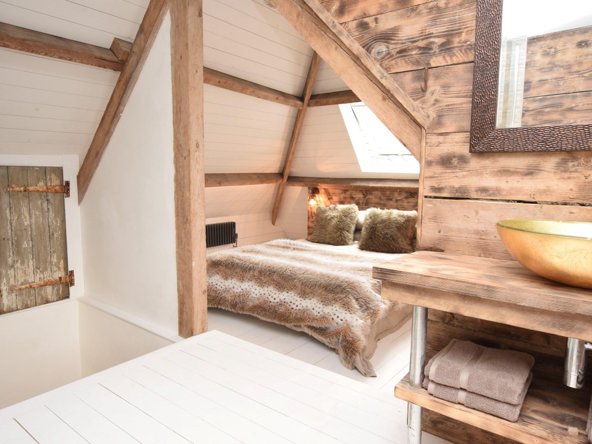 Stylish mezzanine bedroom set into the eaves