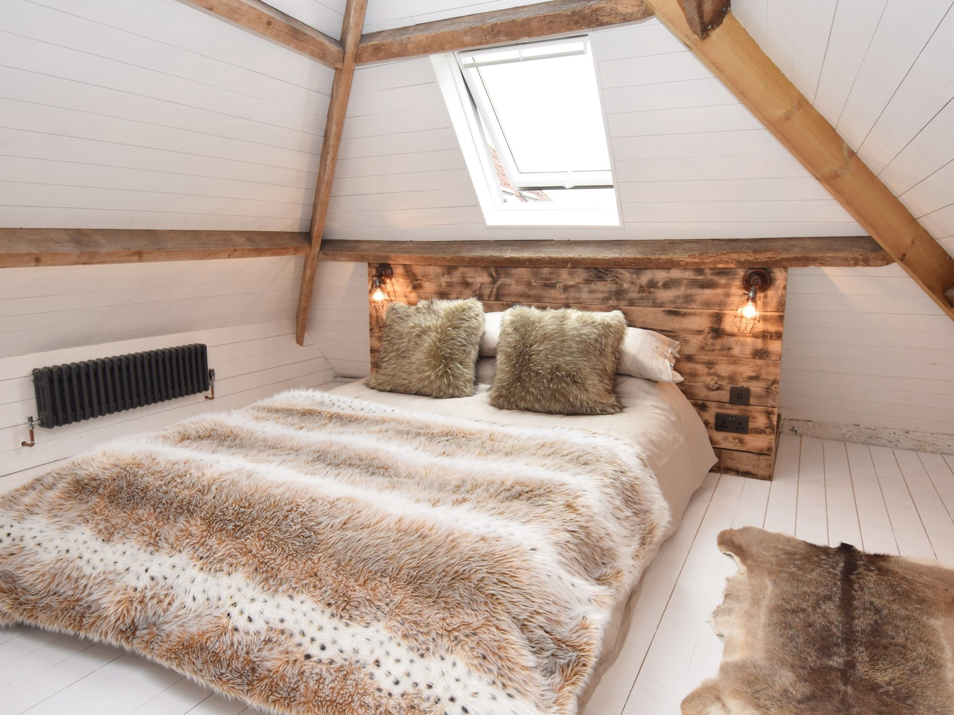 Wake up to the sound of birdsong from the king-size bed