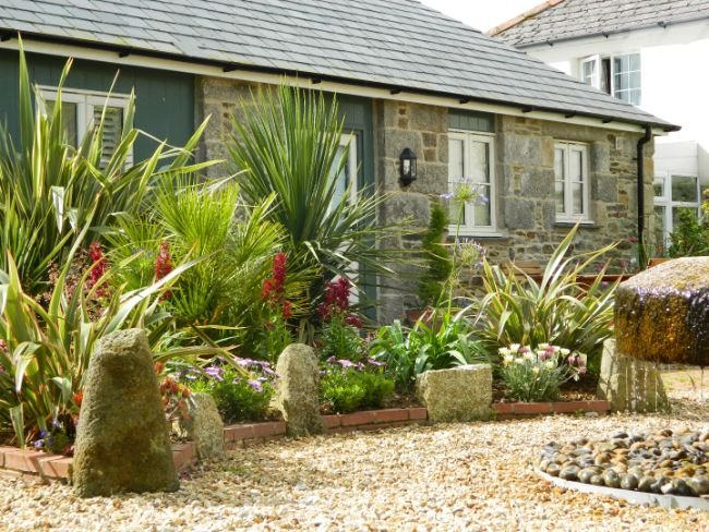Tastefully converted stables with suntrap tropical garden