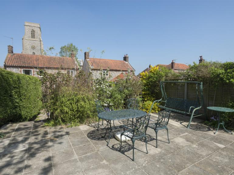The traditional property faces a beautiful medieval church