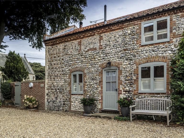 Quaint brick and flint farm building