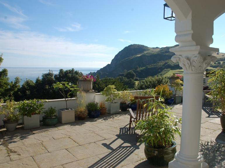Relax on the private terrace and enjoy the sea views