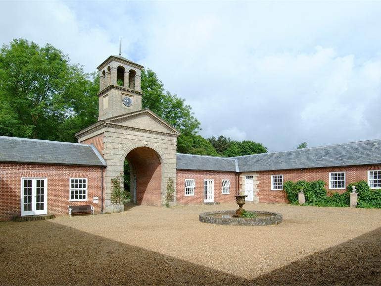 The pretty courtyard and former coach house