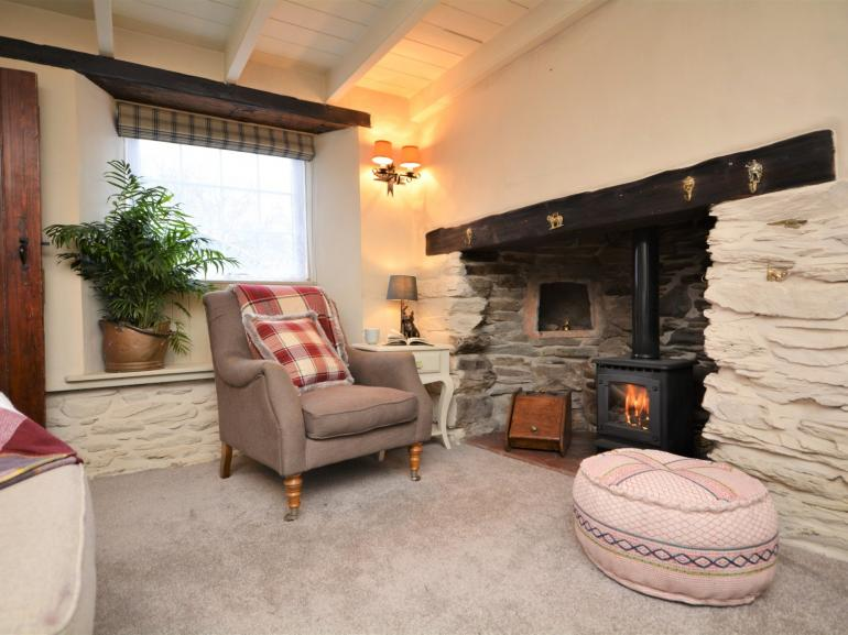 Warm and welcoming lounge with original inglenook fireplace