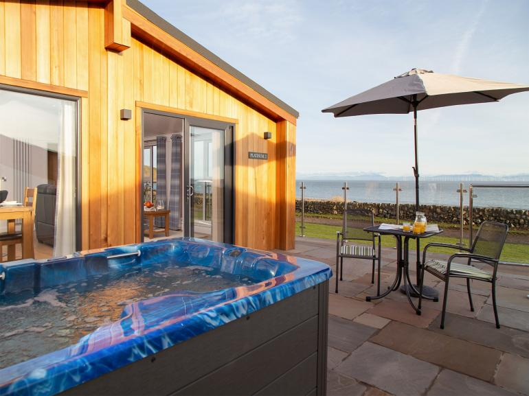 Enjoy the coastal bay views and relax in the hot tub