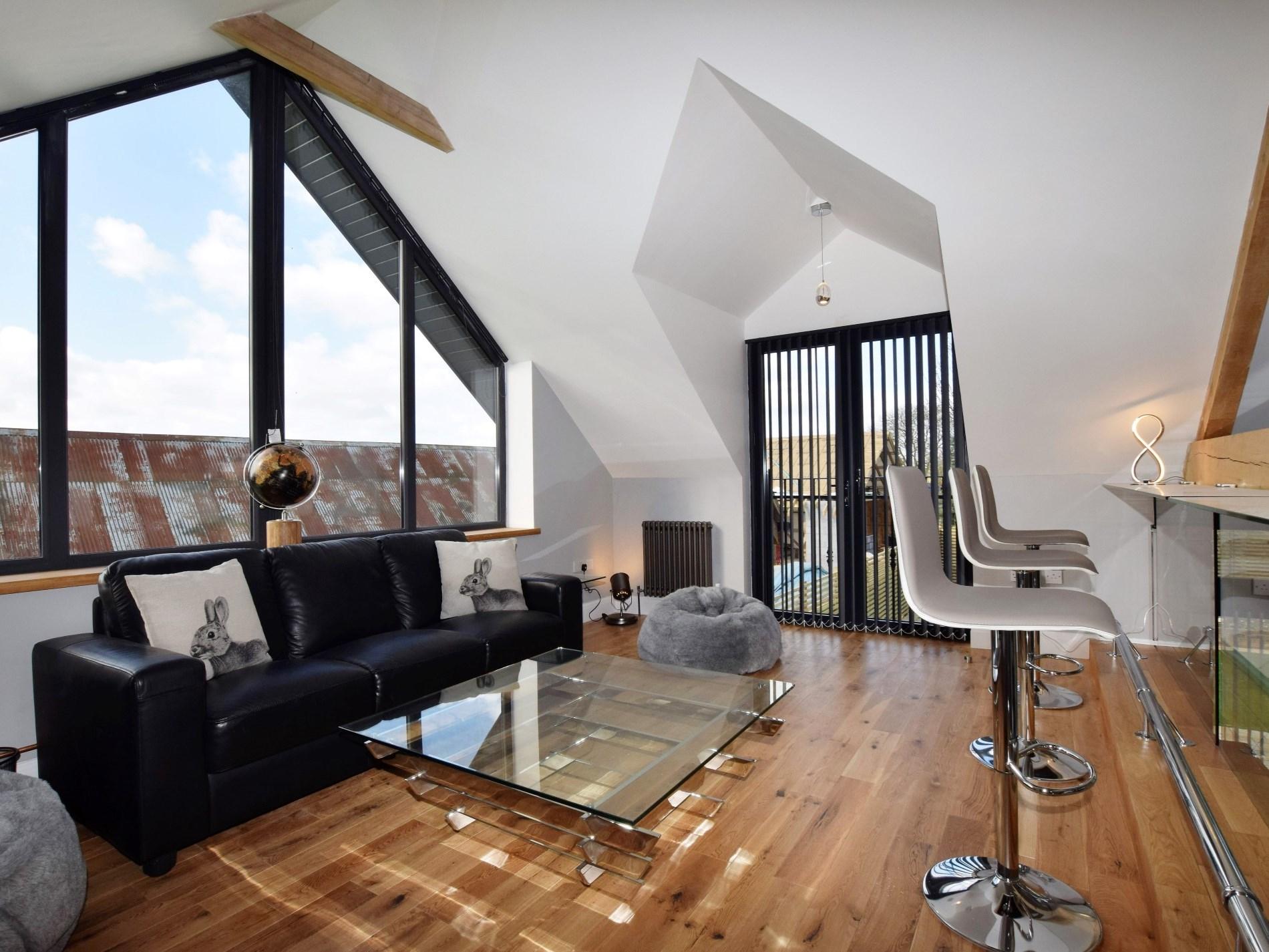 Light snug area overlooking open plan living space