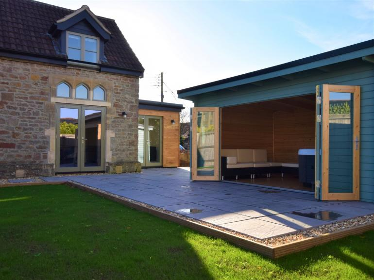 Relax in the private hot tub this remarkable property offers