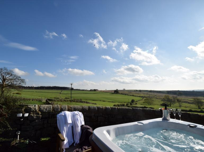 Take in the local countryside from hot tub