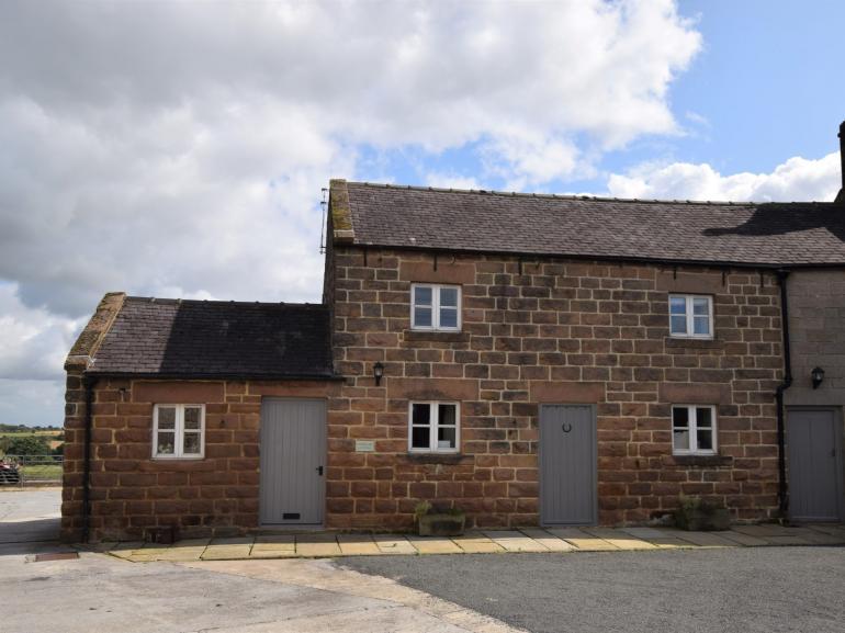 Stone build cottage on working farm