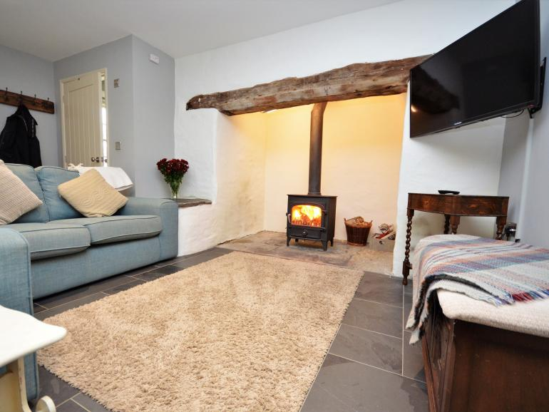 Cosy stone cottage with inglenook fireplace and other period features