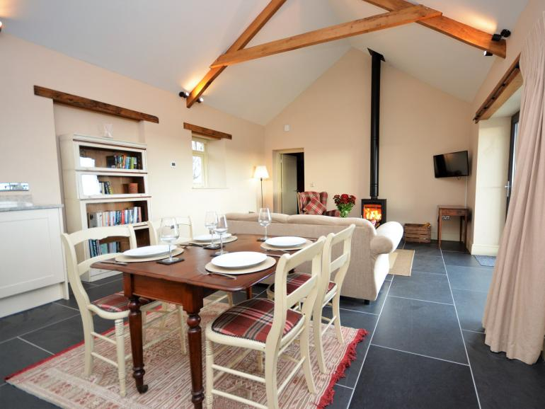 Welcoming, open-plan interior with a warming wood burner
