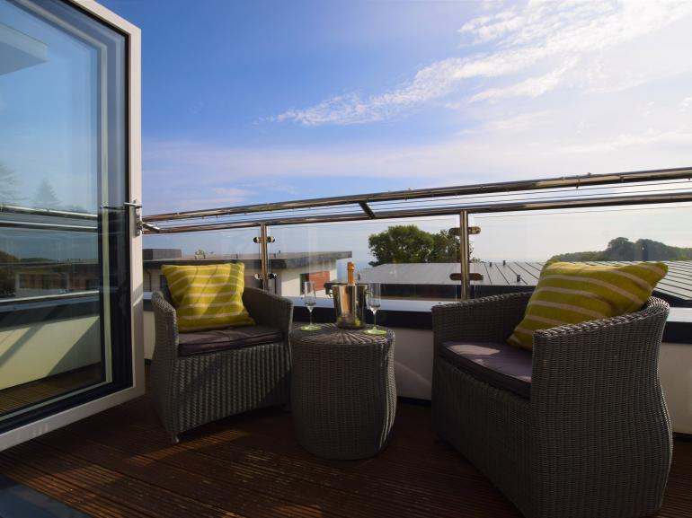 Enjoy beautiful coastal views from the balcony area