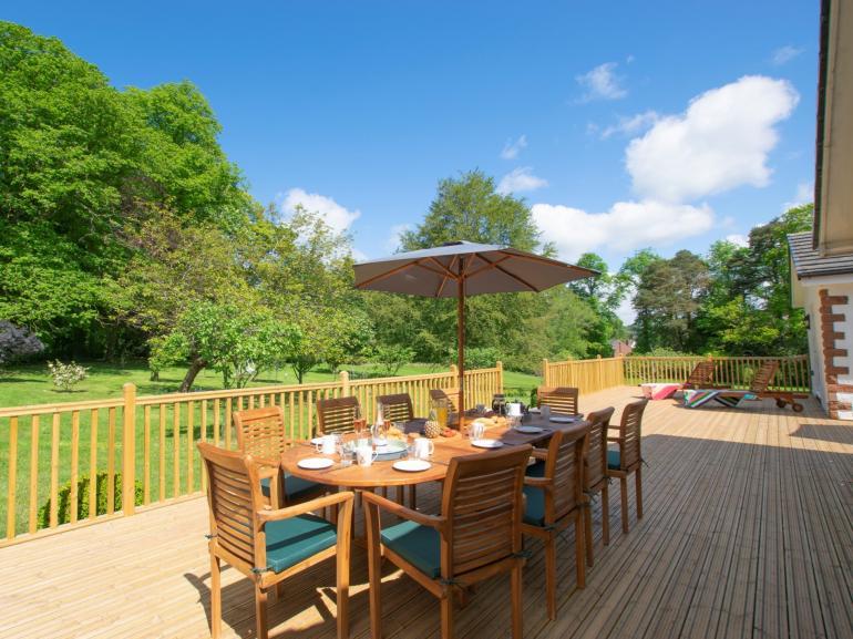 Enjoy dining alfresco overlooking 2 acres of garden