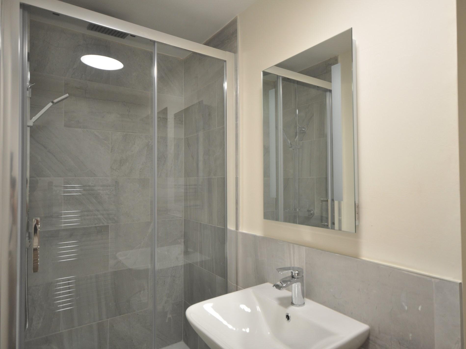 The bedroom has an en-suite shower room