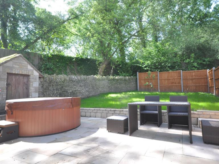 A lovely enclosed garden with private hot tub