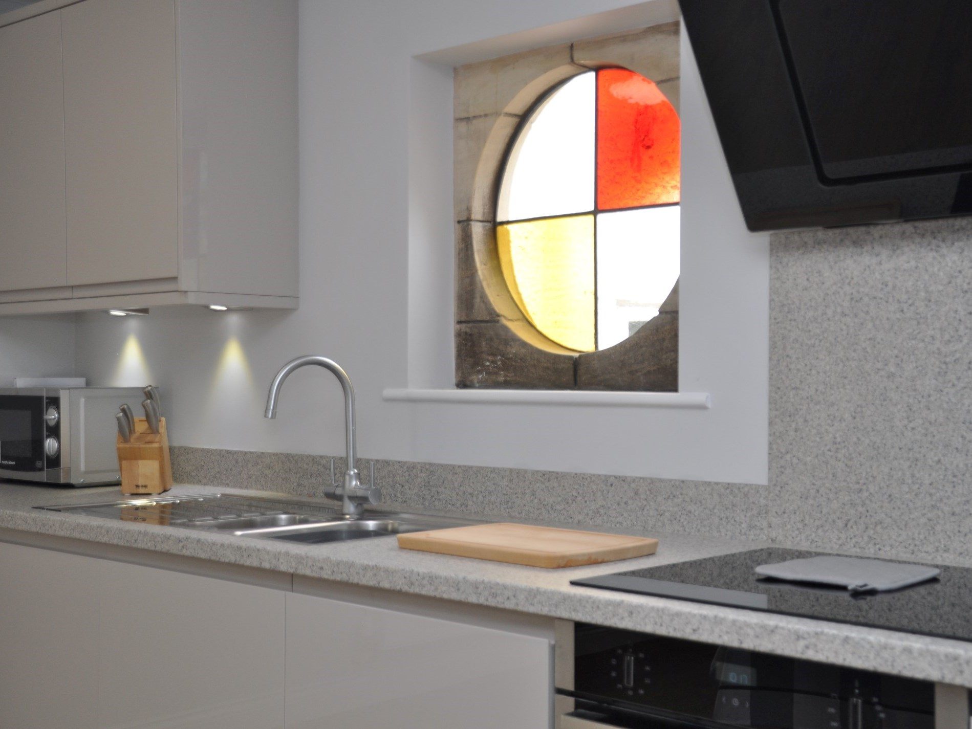 The original round window offers a splash of colour