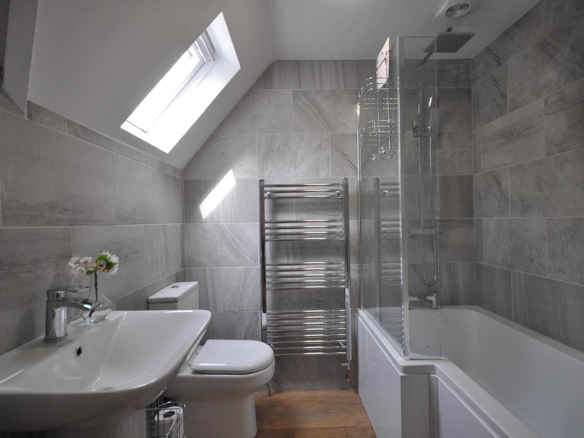 Enjoy soaking in the en-suite bathroom