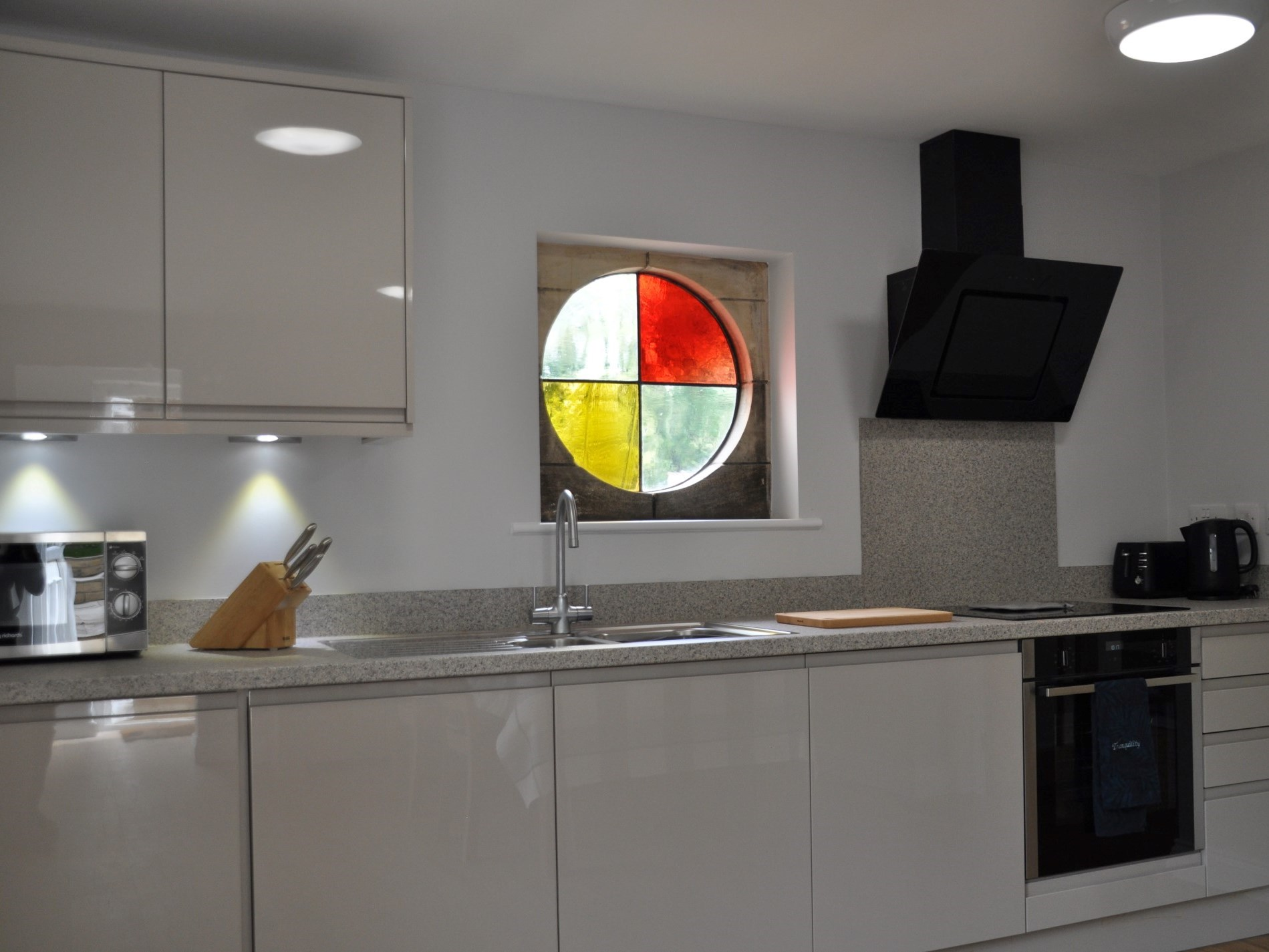 The kitchen is chic and well-equipped