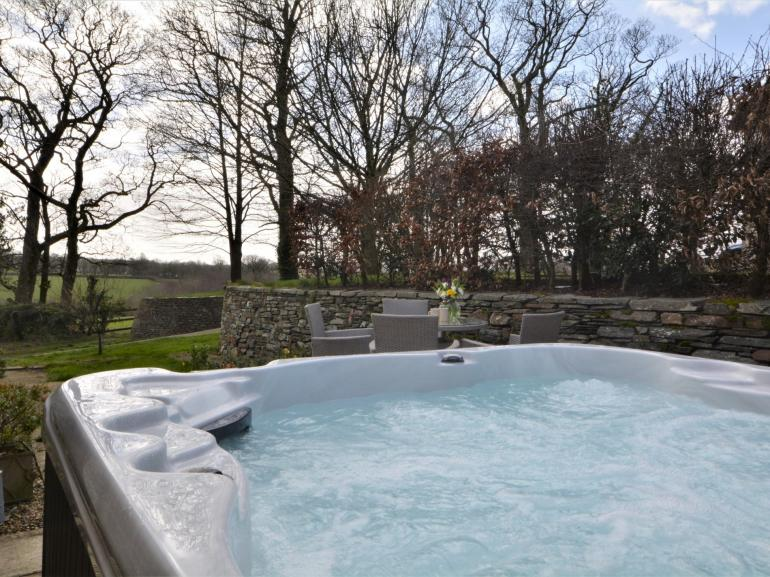 Private hot tub with countryside views