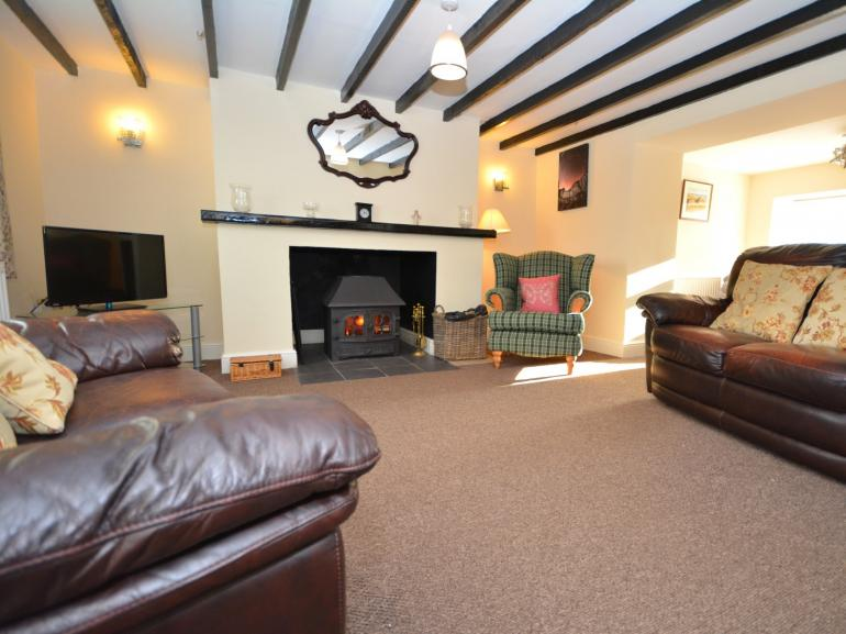 Character lounge with wood burner and exposed beams
