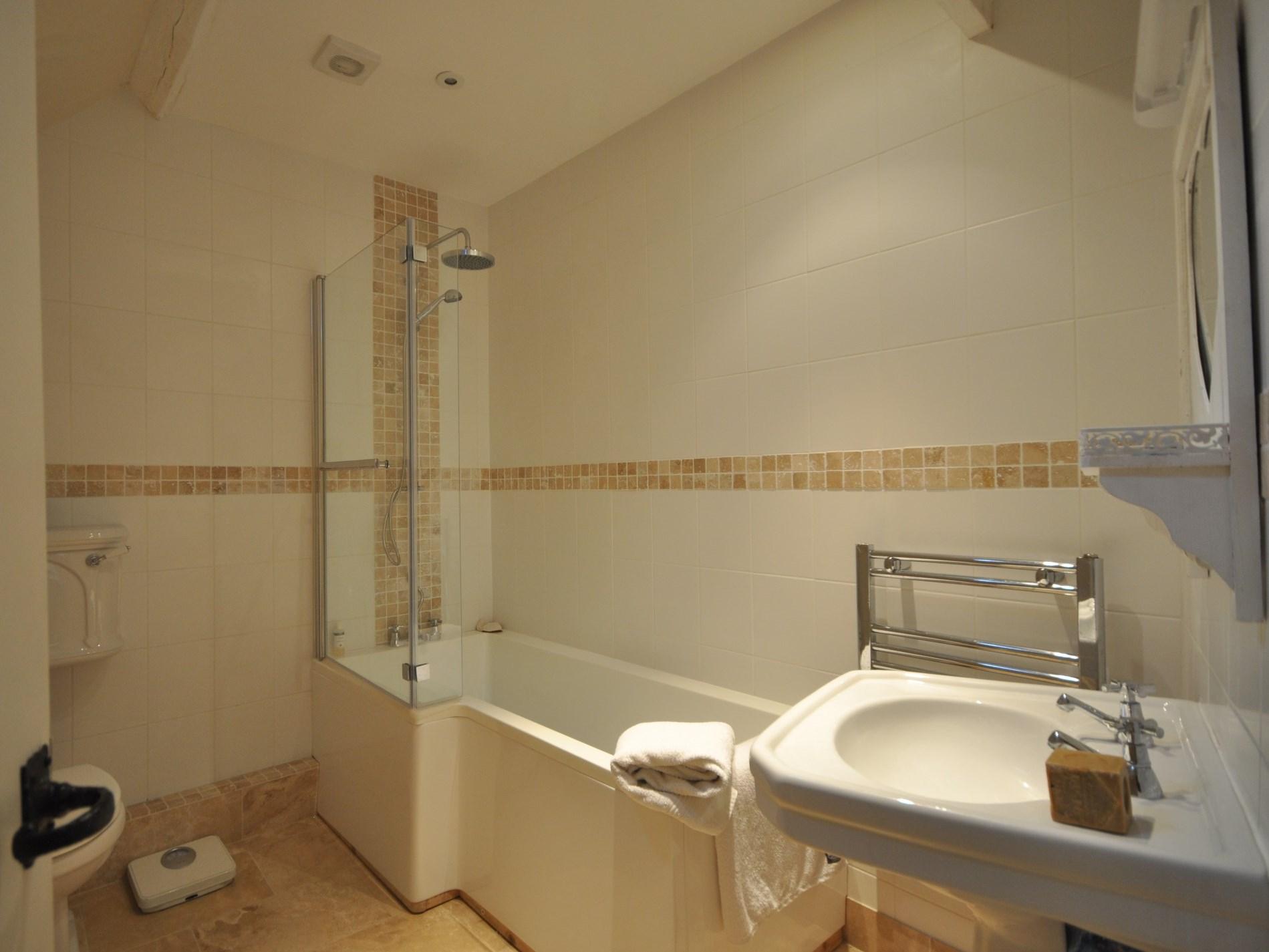 Enjoy soaking in this contemporary bathroom