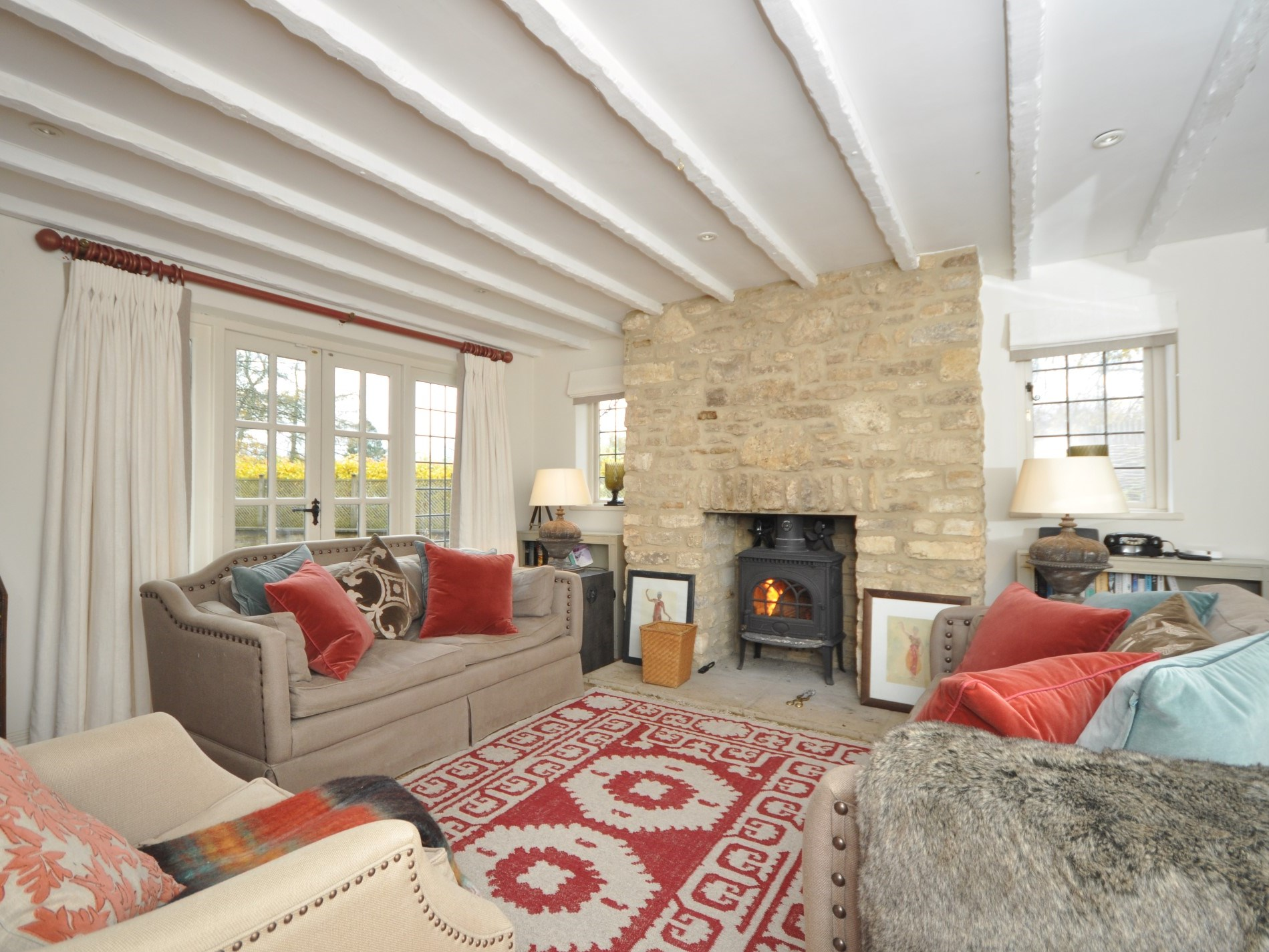 The lounge is cosy with a wood burner and garden views