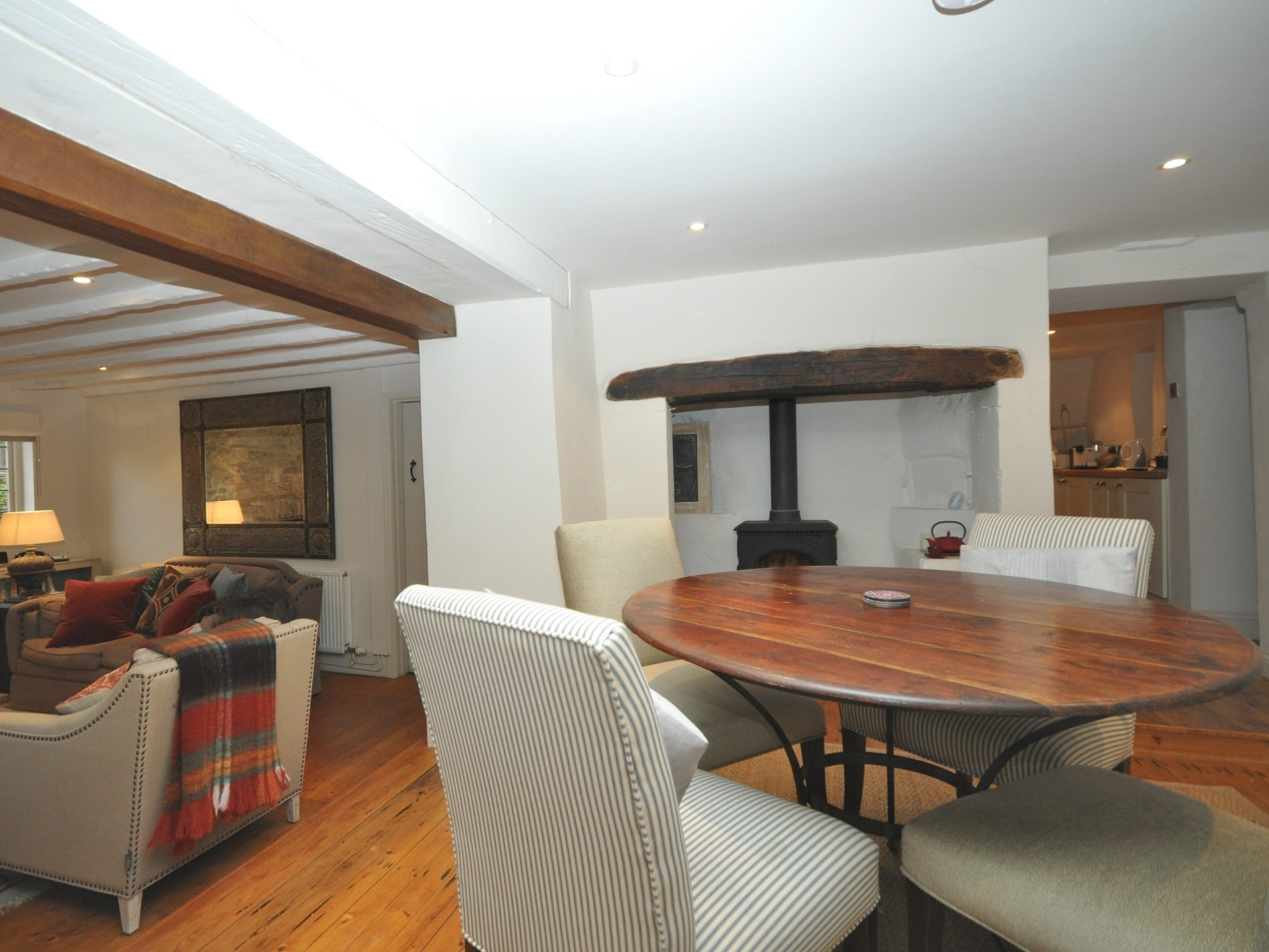 A great table for board games in front of the wood burner