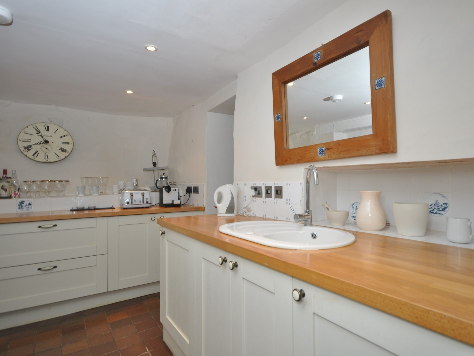 The kitchen has great character with wooden work tops