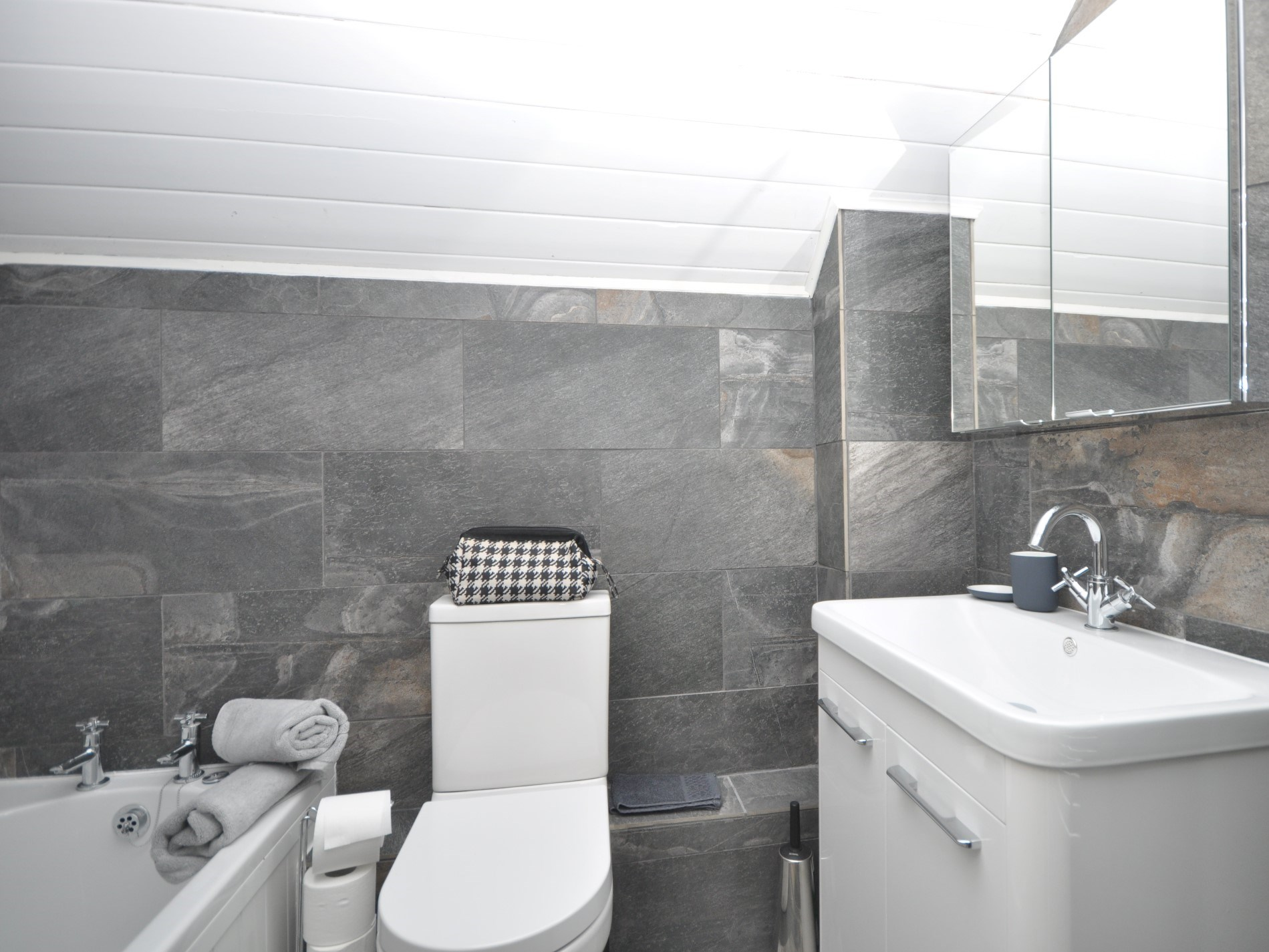 The bathroom with shower over