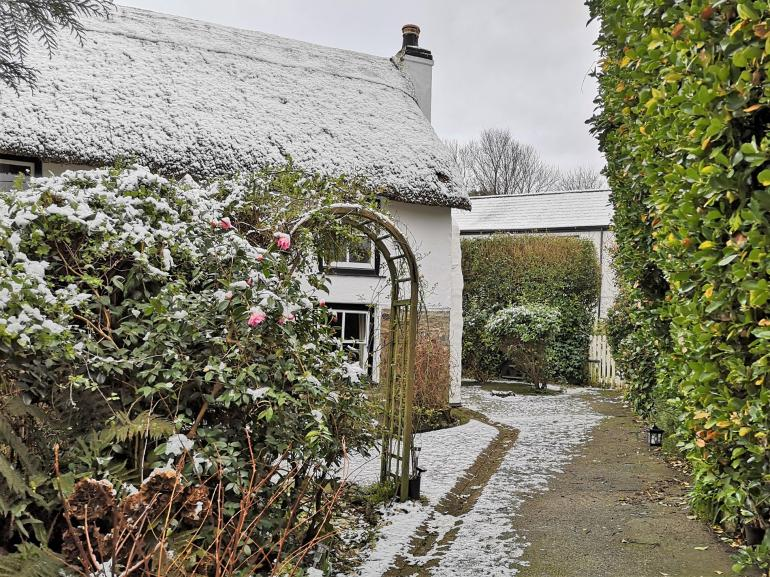 Hunker down in the traditional thatch cottage