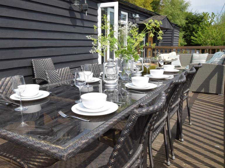 Enjoy eating al fresco on the spacious sun deck of this coastal retreat