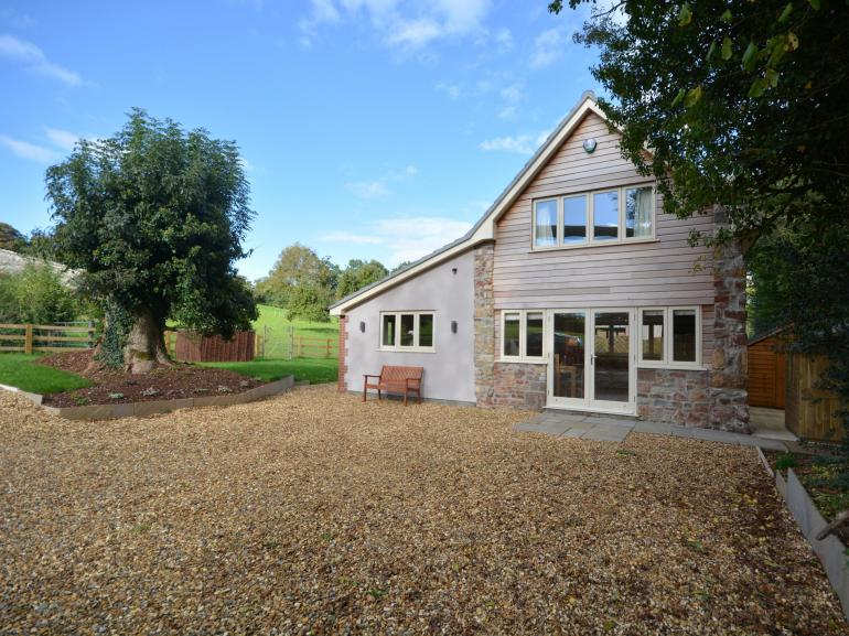 Looking towards this detached property and the owners surrounding farmland
