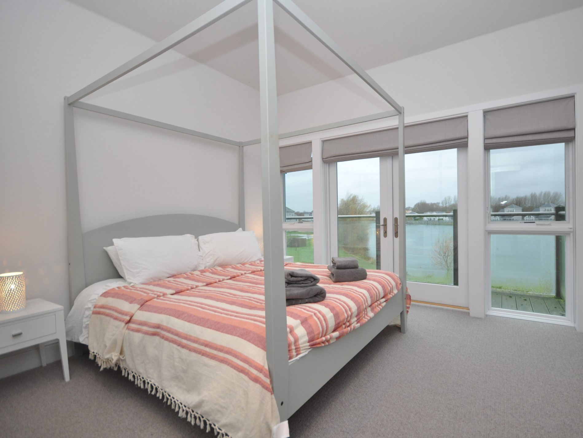 A king-size four poster with great views and en-suite bathroom