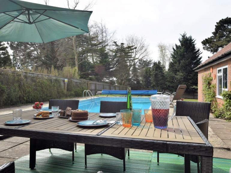 With heated swiming pool this Suffolk home is ideal for large families