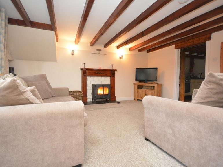 A delightful coach house with cosy lounge and warming wood burner