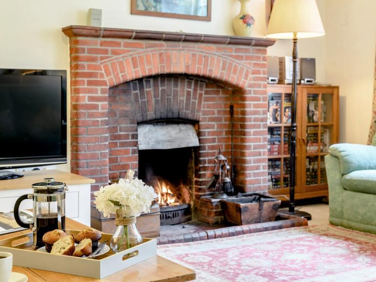 Enjoy afternoon tea in the lounge with the open-fire