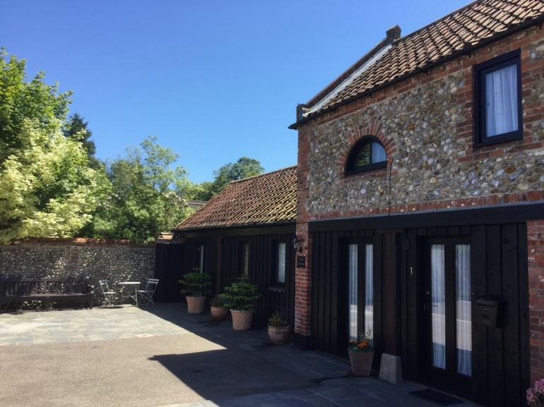 A former coach house situated in the heart of Holt