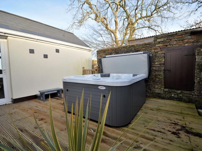 Relax in your own private hot tub situated in courtyard