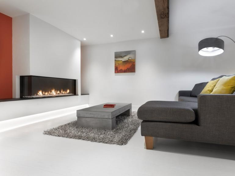 Beautifully presented lounge area with feature fire place