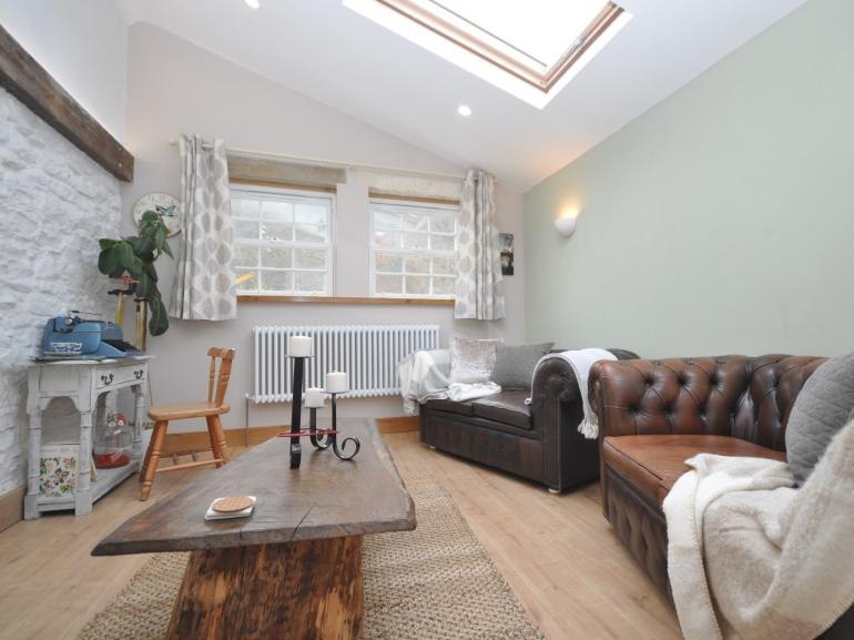 Perfect for relaxing with two cosy sofas in the lounge