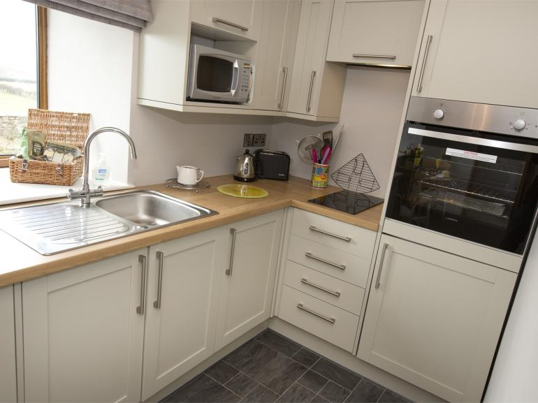 Cosy shaker style kitchen to rustle up a hearty breakfast