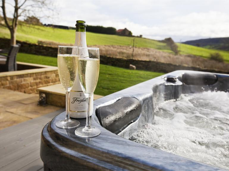 Sit in the hot tub, take in the fresh air and enjoy the view