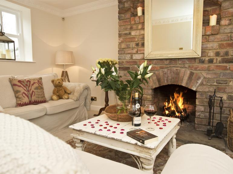 Relax  by the fire in this gorgeous cottage