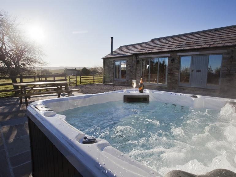 Sit in the hot tub and enjoy the fabulous views