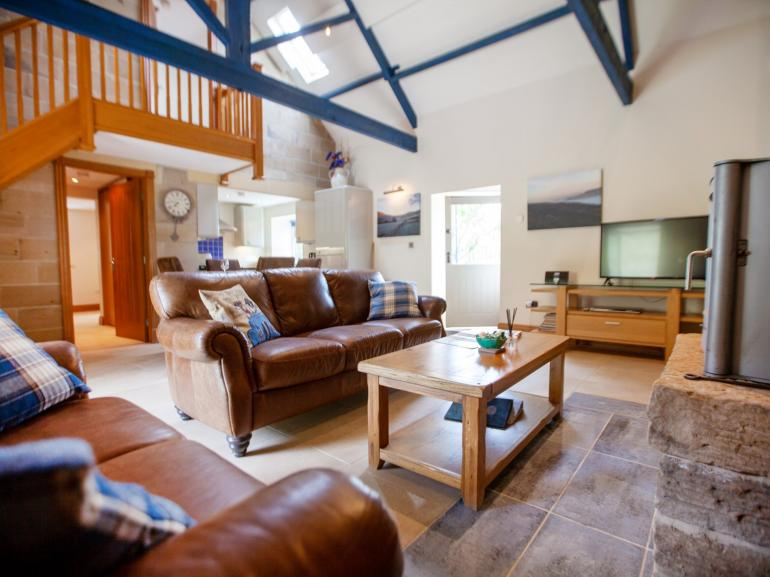 Stunning open plan living space with original beams