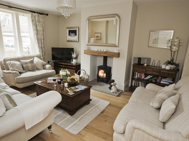 Gorgeous cosy living room with log burning fire