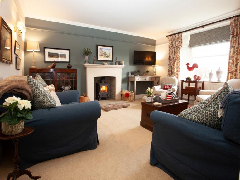 The delightfull, cosy lounge, come on in, relax and enjoy the fire on a winters day