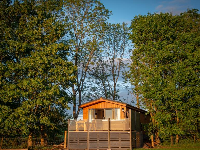 Lodge nested in woodland with unspoilt views