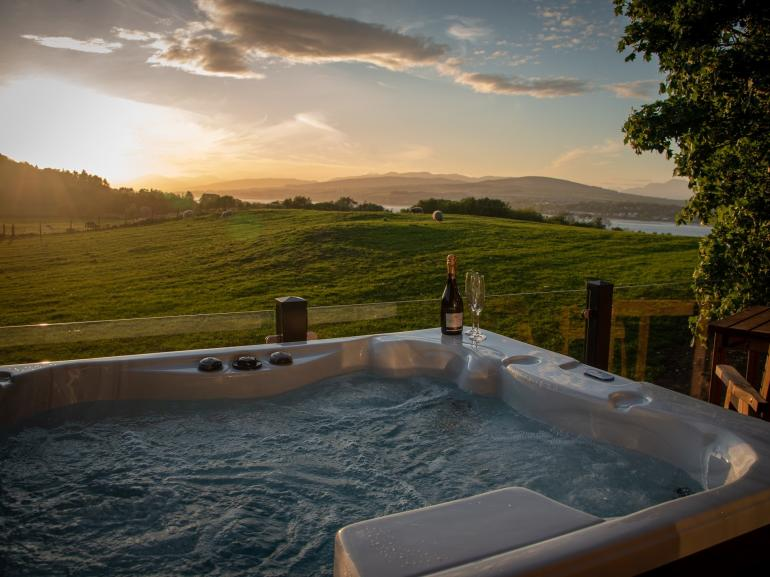 Relax in the private hot tub and admire the views