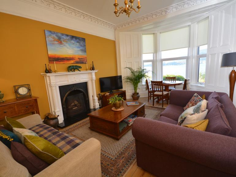 Lounge with period features, open fire and stunning views over the water
